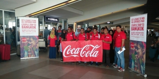 Coca Cola lucky-draw winners leave for Bangkok