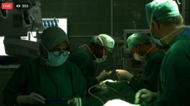 Live spine surgery a success; tens of thousands of views