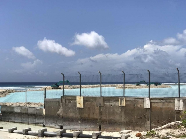 Bund wall under construction for Hulhule' highway