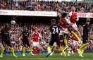 Arsenal twice comes from behind to hold Man City in league