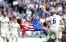Griezmann scores late as Atletico draws at Real Madrid 1-1