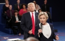 Clinton: My 'skin crawled' as Trump hovered on debate stage