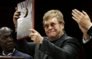 Harvard honors Elton John for efforts to fight HIV, AIDS
