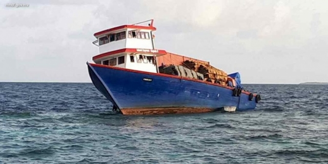 Cargo boat en route to Addu wrecks on reef
