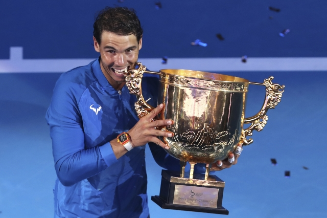 Nadal wins 6th title of year in Beijing; Garcia beats Halep